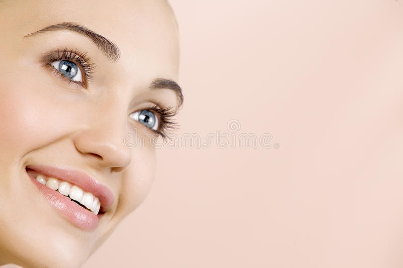 Smile. Portrait of nice young gorgeous woman on pink back stock photos