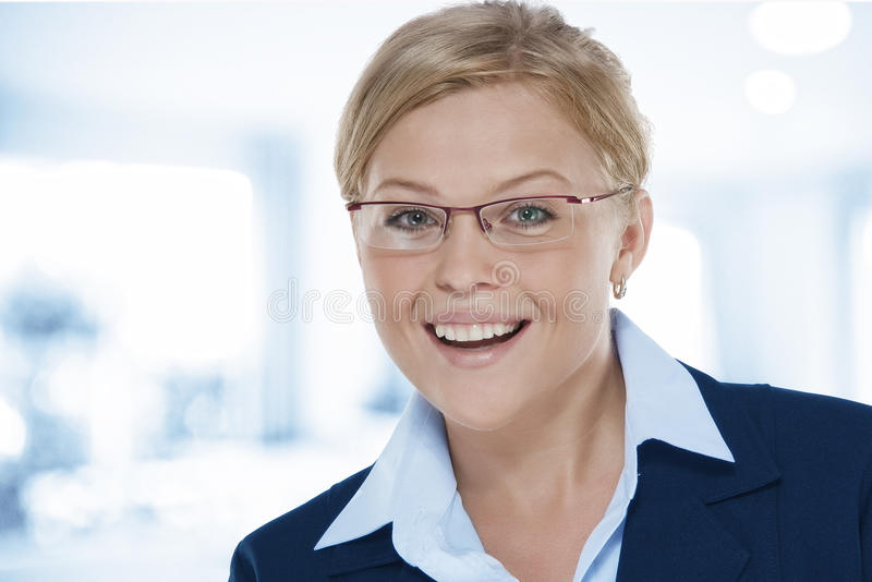 Smile. Portrait of young beautiful woman in office environment stock photo