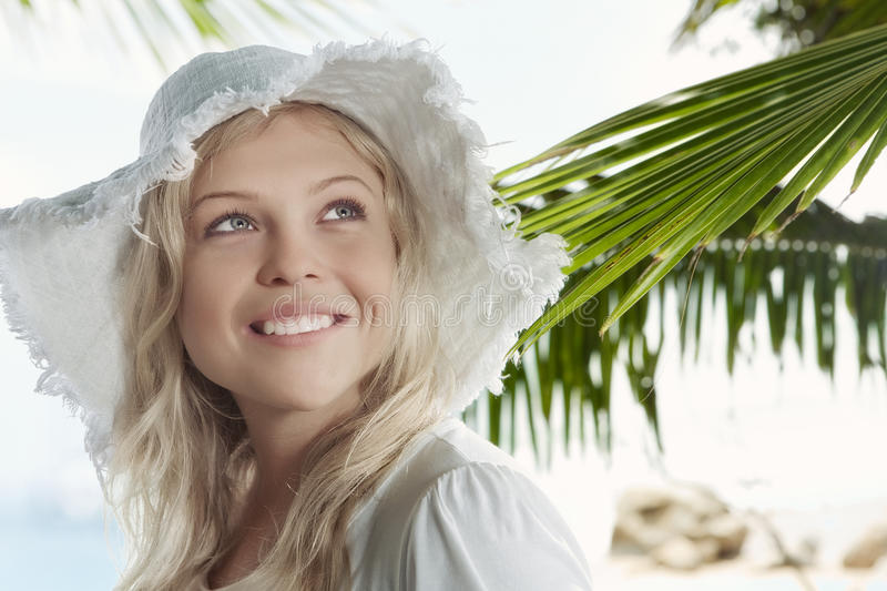 Smile. High key portrait of young beautiful woman in summer environment royalty free stock photo