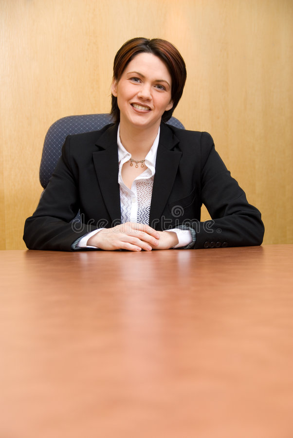 Smile. Happy business woman in a boardroom table stock images