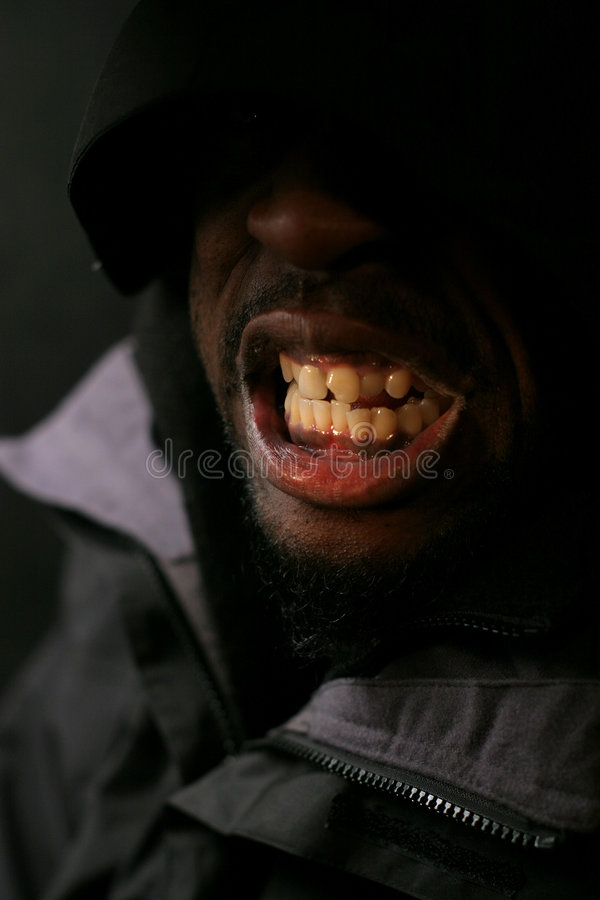 Smile. Black on black royalty free stock image