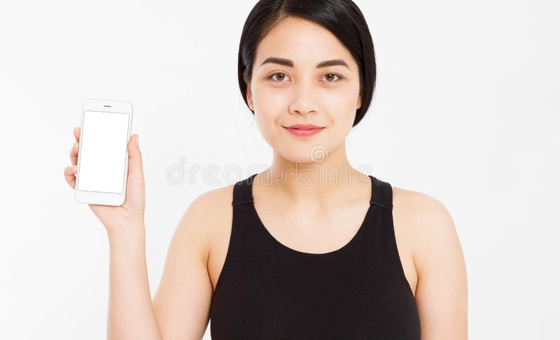 Smile asian girl show empty blank screen mobile phone - pointed on empty display device royalty free stock photography