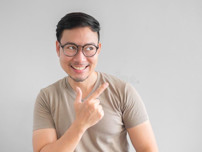 Smile Asian man pointing. royalty free stock image