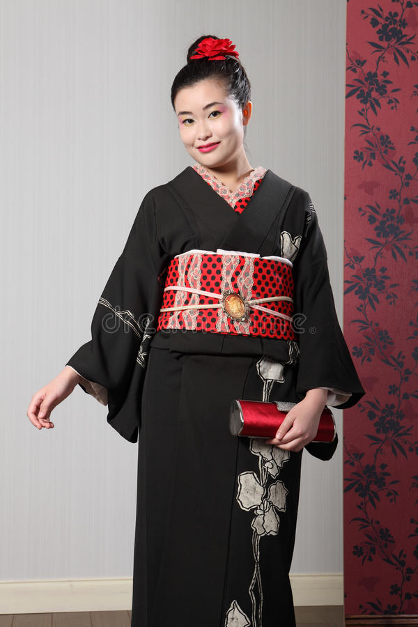 Smile from Asian woman in black japanese kimono