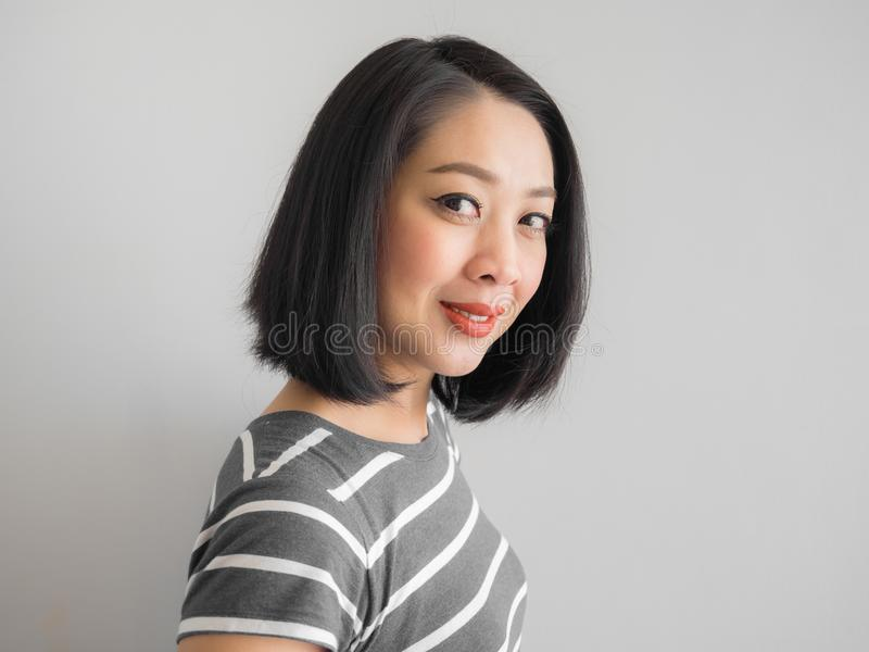 Smile Asian woman making interest look. royalty free stock image