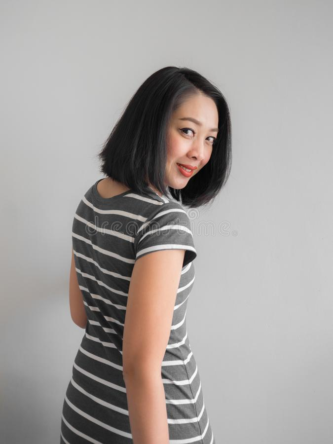 Smile Asian woman making interest look. stock photo