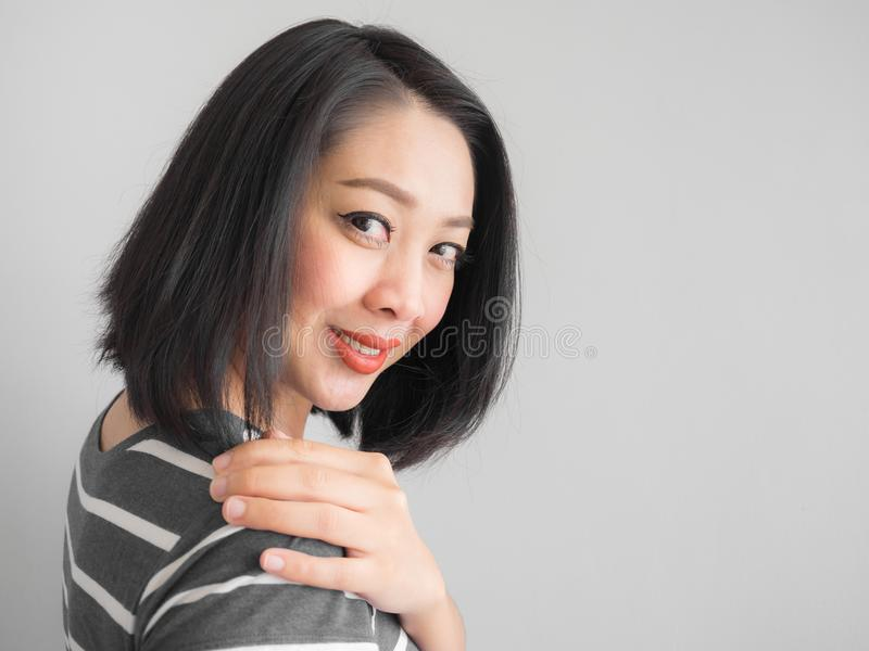 Smile Asian woman making interest look. stock photos