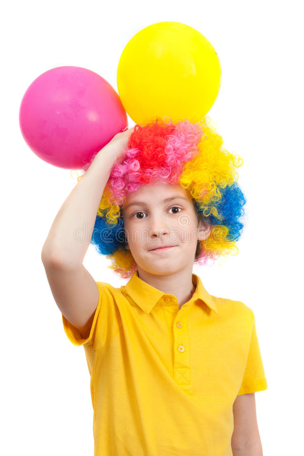 Smile boy in clown wig with two air balloons. Smile boy in clown wig with two balloons, isolated on white background stock photo