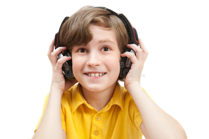 Smile boy listens music. Isolated on white royalty free stock photo