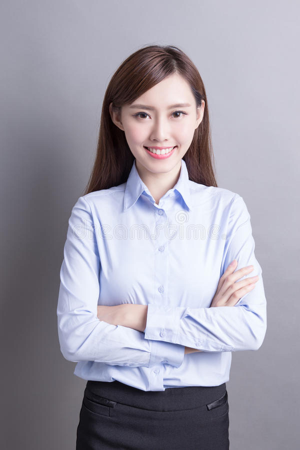 Smile business woman. Confident business woman smile to you isolated over gray background, asian beauty stock photo