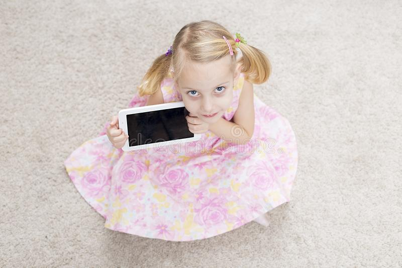 Smile cute girl with tablet royalty free stock photo