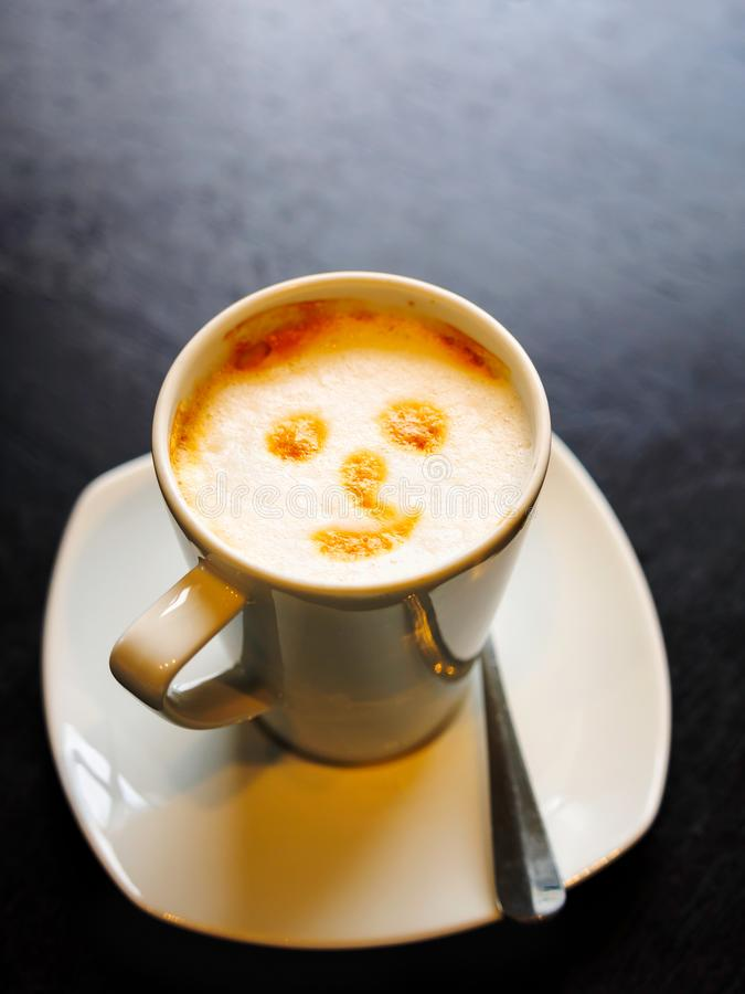 Smile face drawing on coffee stock images