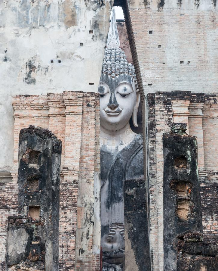 Smile face of the large ancient Buddha statue stock image