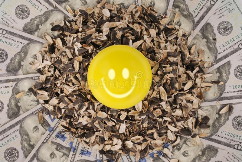 Smile faces and sunflower husk on mandala kaleidoscope from money. Abstract money background raster pattern repeat mandala circle stock image