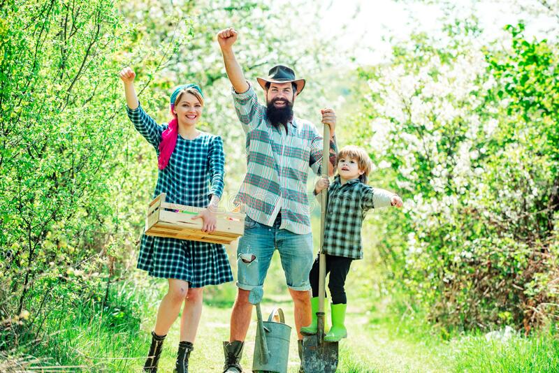 Smile family on farmland. Earth day. Happy family having fun at countryside. Worker family agriculture. Earth concept. royalty free stock image