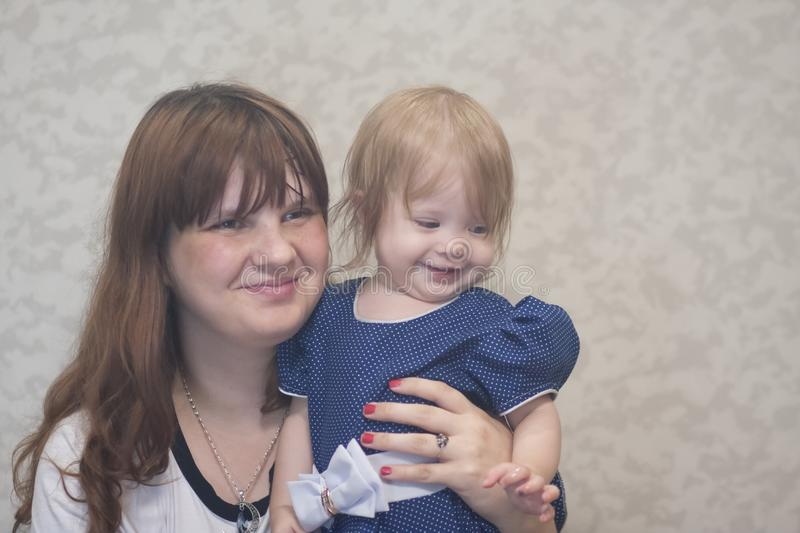 Smile family. mom and little girl. Cognate bond royalty free stock images