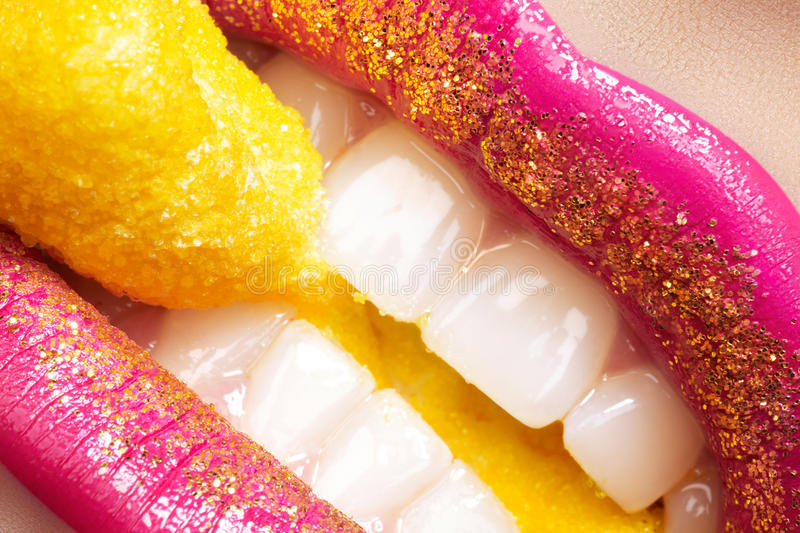 Smile, fashion make-up, white teeth, sweet candy royalty free stock images