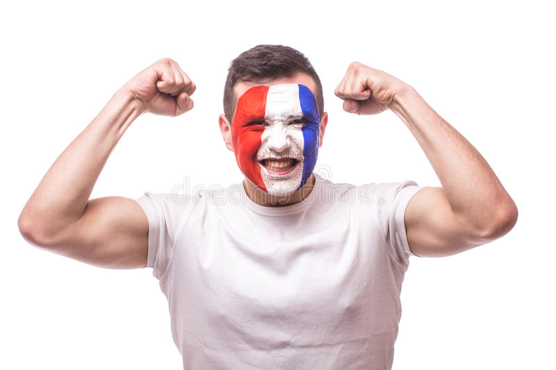 Smile France football fan happy of score of the game or win of the match of France national team. Hands over head. UEFA EURO 2016 football fans concept royalty free stock photography