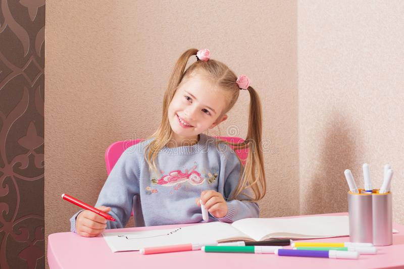 Smile girl drawing at home stock image