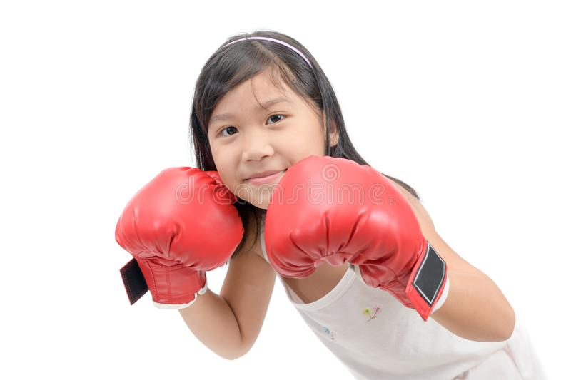 Smile girl fighting with red boxing gloves. On white background, exercise and healthy concept stock photos