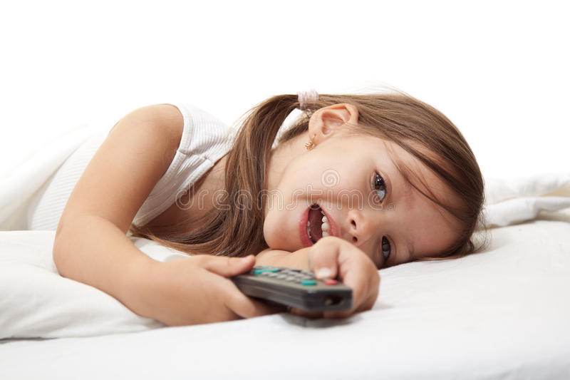 Smile girl with remote control royalty free stock photos