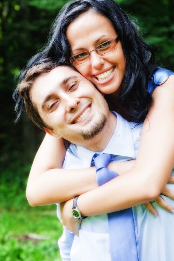 Smile of happy joyful couple embracing