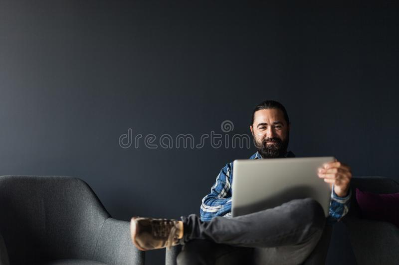 Smile man using laptop, business lifestyle. Corporate portrait, copy space for text royalty free stock photo