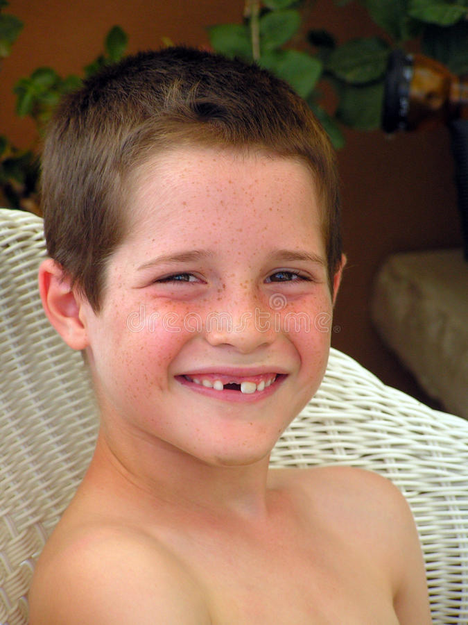 Smile & missing tooth. Boy smiling with missing tooth in is missing tooth royalty free stock photos