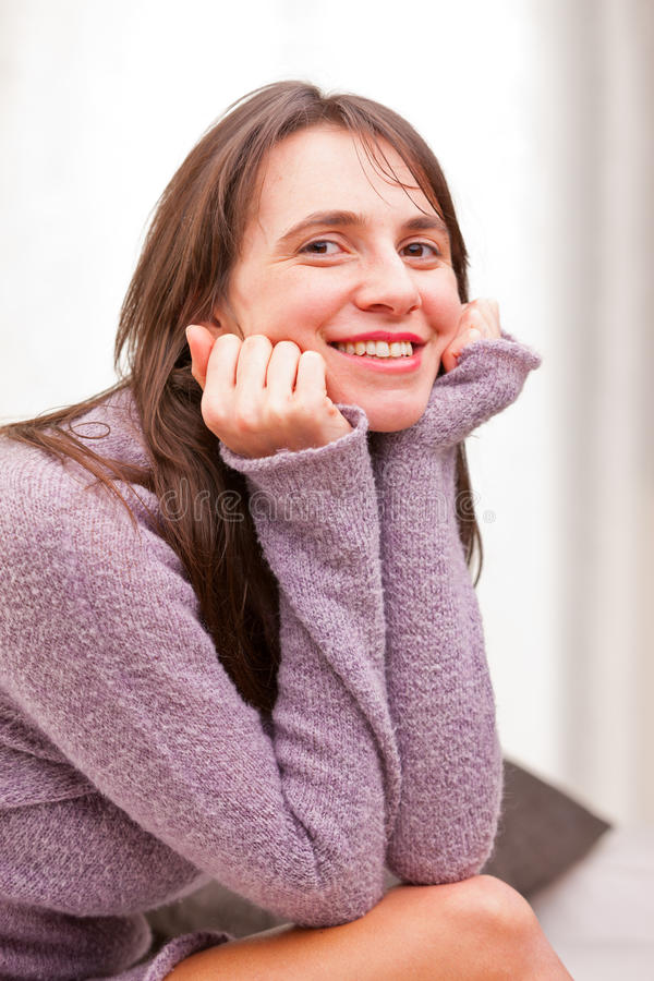 Smile of a satisfied self-confident woman stock image