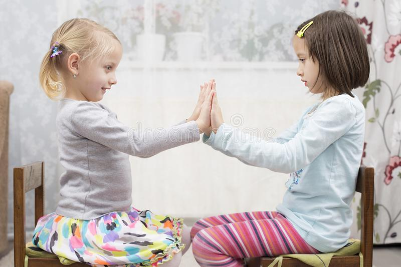 Smile sisters have fun indoor royalty free stock photo