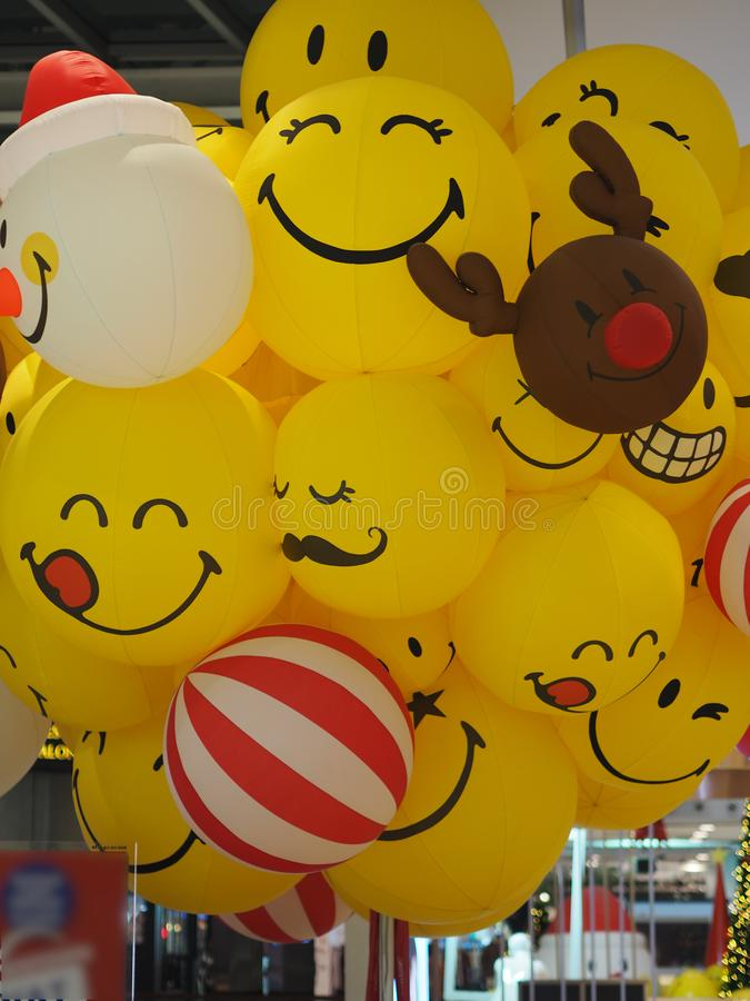 Deer Smile Smiley face yellow ball balloon. Closeup Smile Smiley face yellow ball balloon stock image
