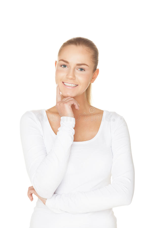 Smile. Smiling girl in white t-shirt on isolated white royalty free stock photography