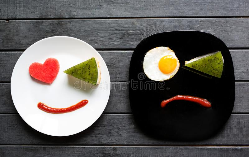 Smile for sweet breakfast with love. Different emotions. People face. Sad or happy. Tasty food royalty free stock photos