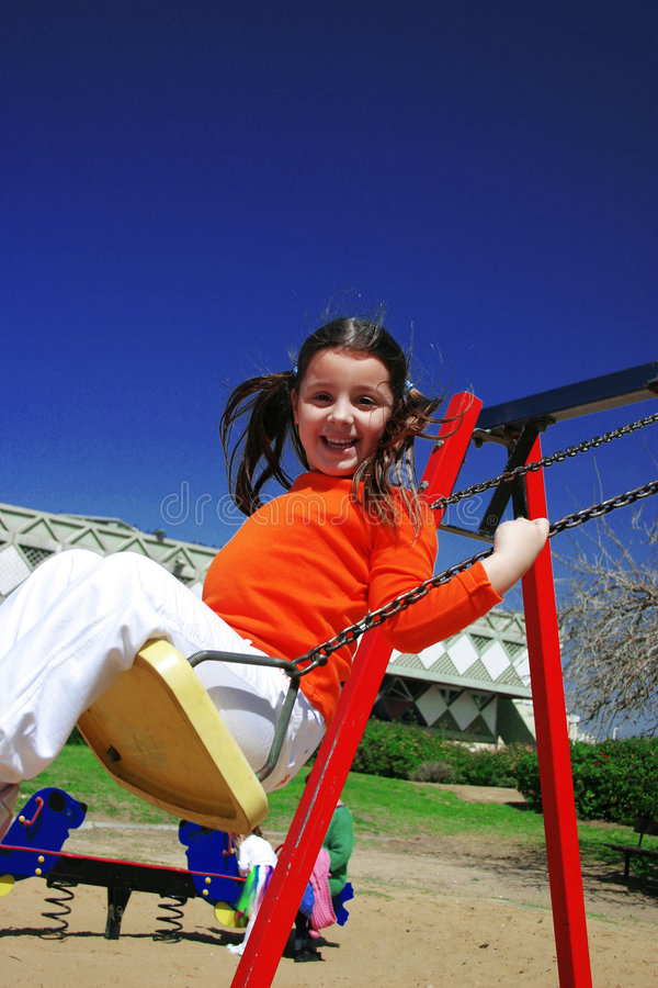 Smile in the swing royalty free stock photography