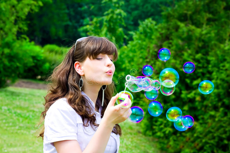 Smile teen with soap bubbles stock image