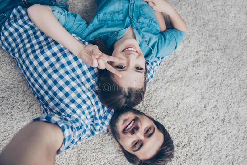 Smile! Upside down shot of a couple of teens. Young siblings are royalty free stock photography