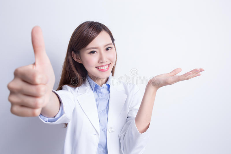 Smile woman doctor show thumb up stock images