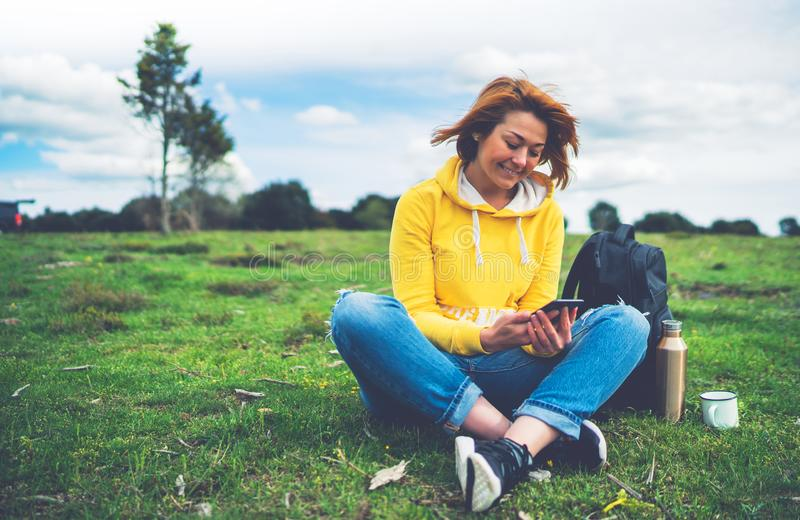 Smile woman holding in female hands gadget technology, tourist young girl text message on background green grass using mobile royalty free stock photography