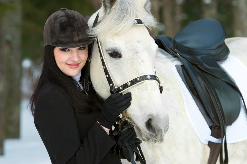 Smile woman jockey. And white horse horse stock photos