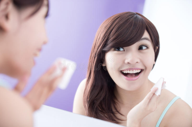 Smile woman remove makeup royalty free stock photo