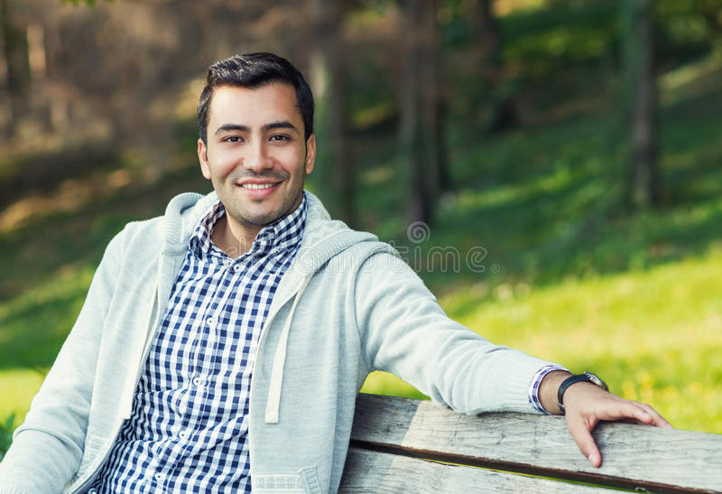 Smile young man. Close up of gorgeous guy, outdoor royalty free stock photo
