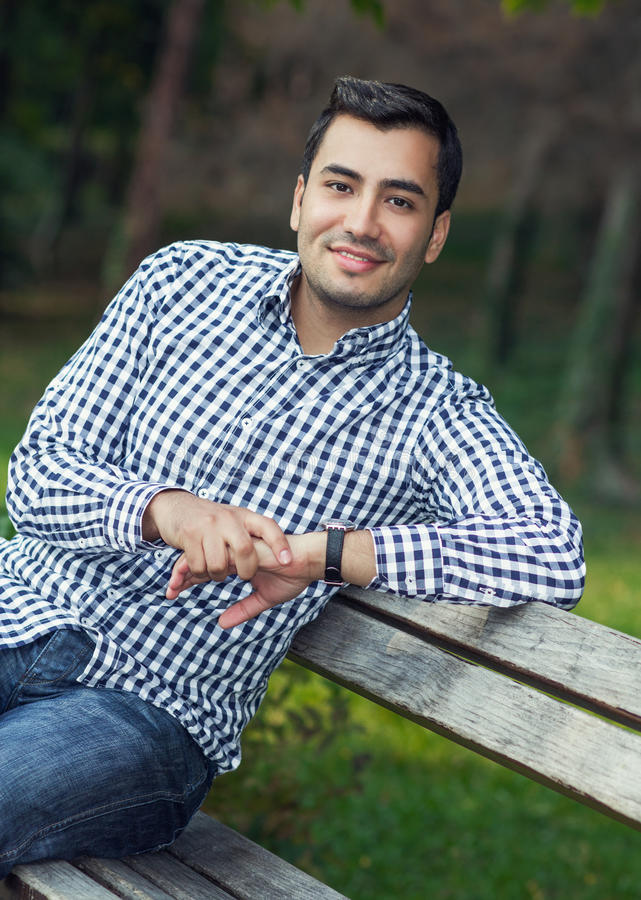 Smile young man, close up of gorgeous guy. Outdoor stock photography