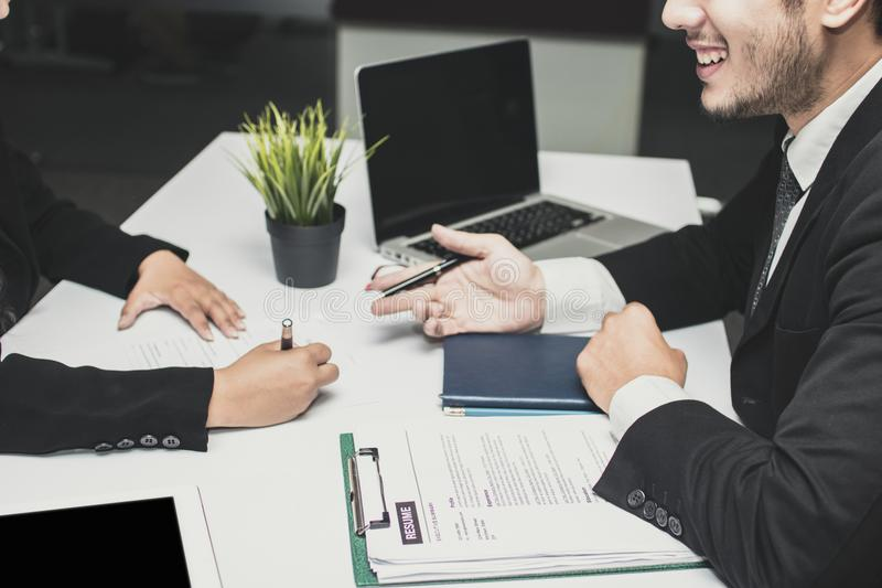 Smiled and happy manager businessman explaining, introducing, ta stock image