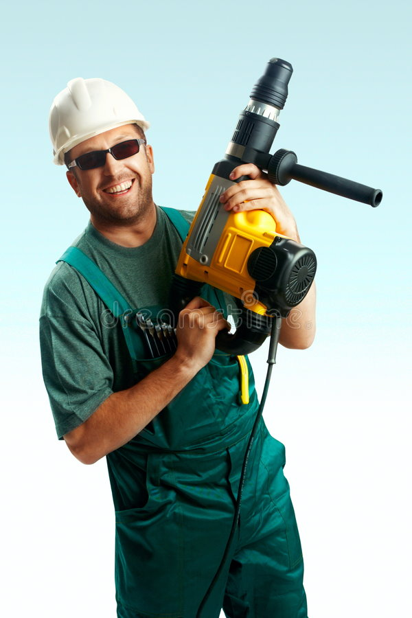 Smiled workman hold perforator stock images