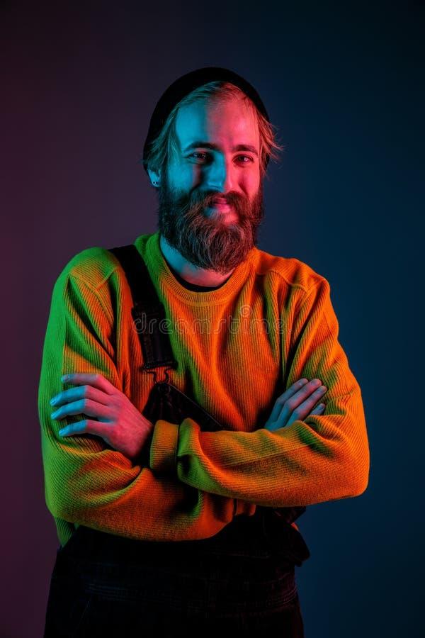 Caucasian man`s portrait isolated on gradient studio background in neon light royalty free stock photo