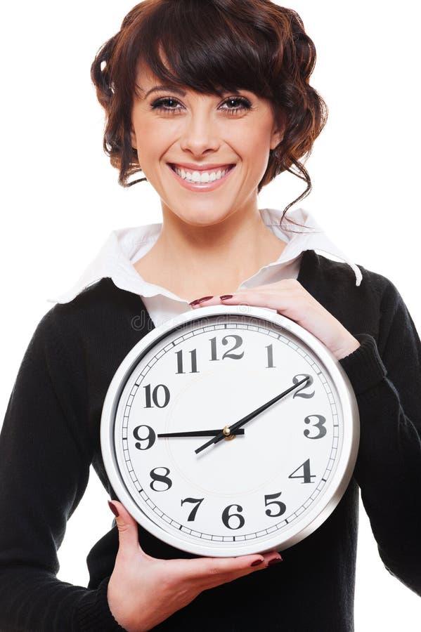 smiley удерживания часов коммерсантки стоковые фото