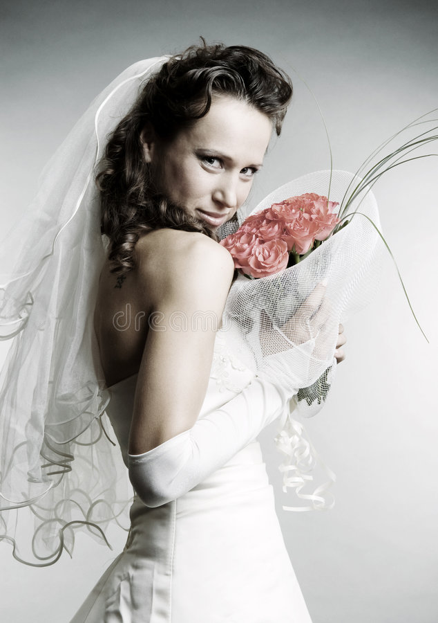 Smiley bride with bouquet of flowers
