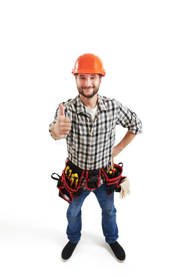 Smiley budowniczy w ciężkim kapeluszu i pasku fotografia stock