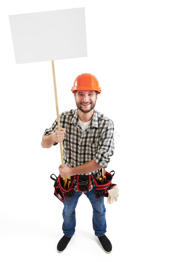 Smiley budowniczy z białym plakatem zdjęcia stock