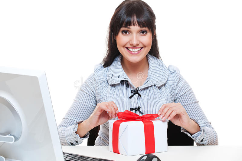 Smiley businesswoman pack up small present royalty free stock photography